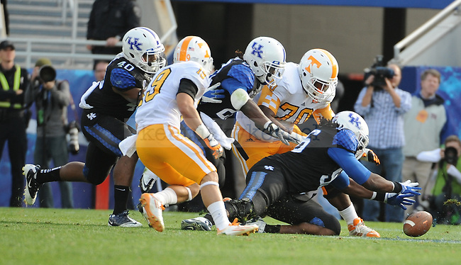 UK Defensive lineman Collins Ukwu recovers a fumble during the third quarter of the University of Kentucky football game against Tennessee at Commonwealth Stadium in Lexington, Ky., on 11/26/11. UK won the game 10-7. Photo by Bob Weaver | Staff