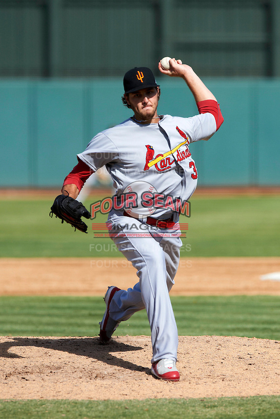 Surprise Saguaros pitcher Kevin Siegrist #38, of the St. Louis Cardinals organization, during an Arizona Fall League game against the Phoenix Desert Dogs at Phoenix Municipal Stadium on October 18, 2012 in Phoenix, Arizona.  The game was called after eleven innings with a 2-2 tie.  (Mike Janes/Four Seam Images)
