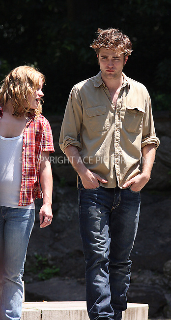WWW.ACEPIXS.COM . . . . .  ....June 30 2009, New York City....Actors Robert Pattinson and Emilie De Ravin on the Central Park set of the new movie 'Remember Me' on June 30 2009 in New York City....Please byline: AJ Sokalner - ACEPIXS.COM..... *** ***..Ace Pictures, Inc:  ..tel: (212) 243 8787..e-mail: info@acepixs.com..web: http://www.acepixs.com