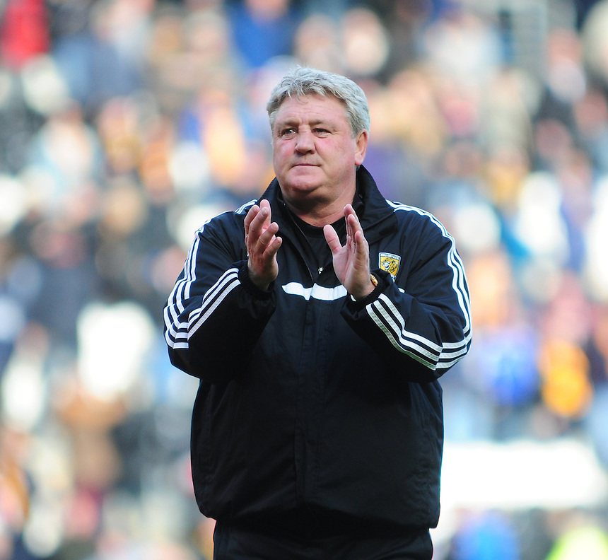 Hull City's Manager Steve Bruce applauds the fans at the end of the game<br /> <br /> Photographer Chris Vaughan/CameraSport<br /> <br /> Football - Barclays Premiership - Hull City v Everton - Sunday 11th May 2014 - Kingston Communications Stadium - Hull<br /> <br /> &copy; CameraSport - 43 Linden Ave. Countesthorpe. Leicester. England. LE8 5PG - Tel: +44 (0) 116 277 4147 - admin@camerasport.com - www.camerasport.com