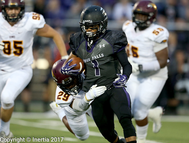 SIOUX FALLS, SD - SEPTEMBER 23: Jason Towns #1 from the University of Sioux Falls is brought down from behind by Anfernee Cooper #29 from Minnesota Crookston in the first half of their game Saturday night at Bob Young Field in Sioux Falls. (Photo by Dave Eggen/Inertia)