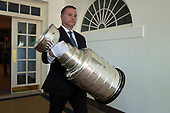 The Stanley Cup is carried to the Rose Garden for an event with United States President Donald J. Trump, where he hosted the St. Louis Blues, the 2019 Stanley Cup Champions, at the White House in Washington D.C., U.S. on Tuesday, October 15, 2019.<br /> <br /> Credit: Stefani Reynolds / CNP