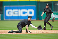 Vanderbilt Commodores shortstop Connor Kaiser (12) fields a throw at second base as Ethan Paul (10) looks on during the game against the Sam Houston State Bearkats in game one of the 2018 Shriners Hospitals for Children College Classic at Minute Maid Park on March 2, 2018 in Houston, Texas. The Bearkats walked-off the Commodores 7-6 in 10 innings.   (Brian Westerholt/Four Seam Images)