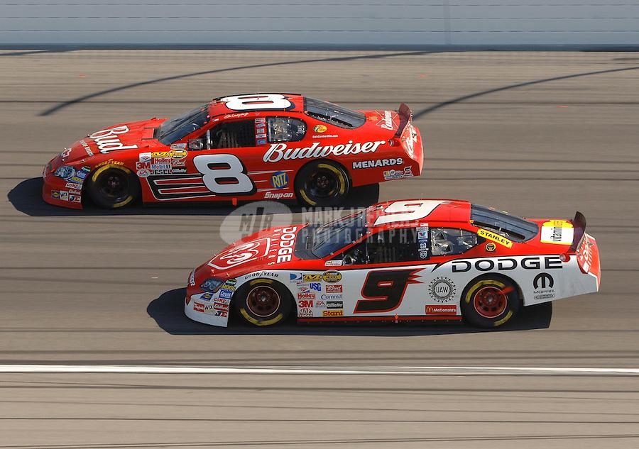 Oct 1, 2006; Kansas City, KS, USA; Nascar Nextel Cup driver Dale Earnhardt Jr (8) leads Kasey Kahne (9) during the Banquet 400 at Kansas Speedway. Mandatory Credit: Mark J. Rebilas