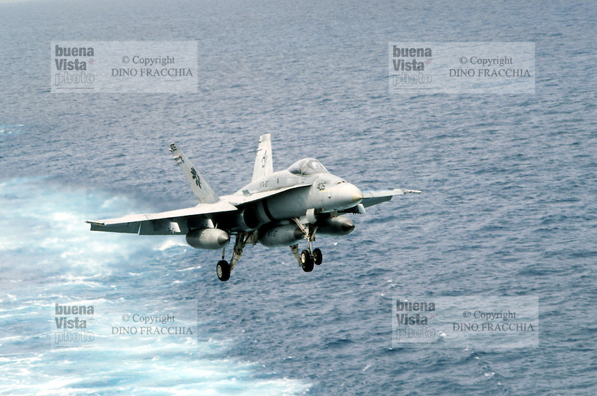 "- deck-landing of a F 18 ""Hornet"" fighter bomber aircraft on Roosevelt aircraft carrier....- appontaggio di un cacciabombardiere F 18 ""Hornet"" a bordo della portaerei Roosevelt  .."