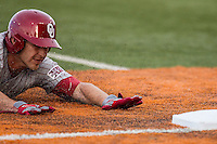Oklahoma Sooners third baseman Garrett Carey #10 slides into third base against the Texas Longhorns in the NCAA baseball game on April 5, 2013 at UFCU DischFalk Field in Austin Texas. Oklahoma defeated Texas 2-1. (Andrew Woolley/Four Seam Images).