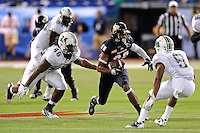 20 December 2011:  FIU wide receiver Jacob Younger (88) attempts to evade Marshall running back Remi Watson (5) and linebacker Jermaine Holmes (46) after a reception in the third quarter as the Marshall University Thundering Herd defeated the FIU Golden Panthers, 20-10, to win the Beef 'O'Brady's St. Petersburg Bowl at Tropicana Field in St. Petersburg, Florida.