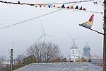 Wind turbines backdrop the small Romanian town of Fantanele.
