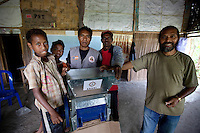 May 3rd 2012_ LACLUBAR, TIMOR-LESTE_ Residence of the mountain town of Laclubar, inspect a new hand pulping machine donated to them by The Hummingfish Foundation.  The pulper is part of an organic coffee farmer support project, designed to improve the farmer's coffee and create a high end brand as well.  Photographer: Daniel J. Groshong/The Hummingfish Foundation