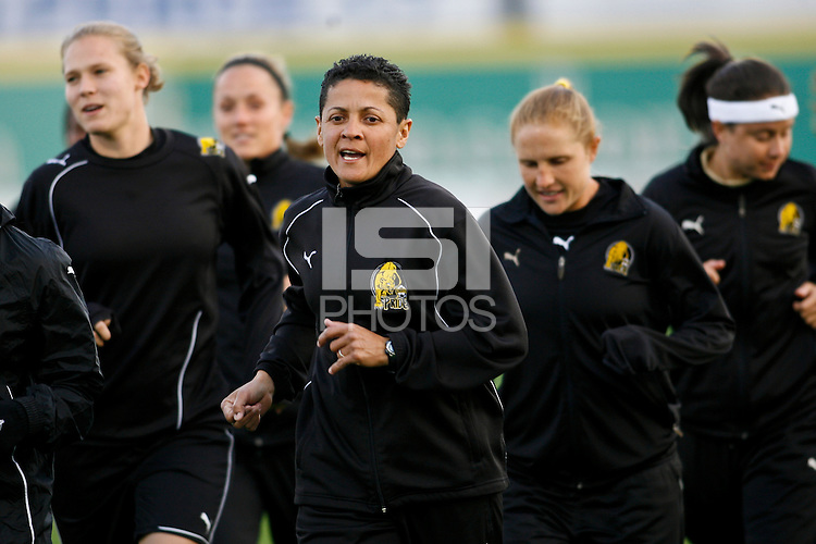"FC Gold Pride assistant coach Sisleide ""Sissi"" Lima Do Amor leads the team during warm ups. Sky Blue FC and FC Gold Pride played to a 1-1 tie during a Women's Professional Soccer match at TD Bank Ballpark in Bridgewater, NJ, on April 11, 2009."