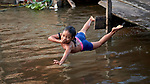 An indigenous girl dives into the Javari River at Atalaia do Norte in Brazil's Amazon region.