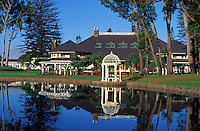Gazebo and buildings reflected in a pond on the grounds of the lodge at Koele, Lanai