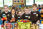 Emily Twamley, Bayan Bougattaya Daly, Ashley Nic Artúir, Muiris Mac Caochlaoich agus Conaill De Locke, pictured on their first day of school at Gaelscoil Mhic Easmainn, Tralee, on Wednesday morning last.