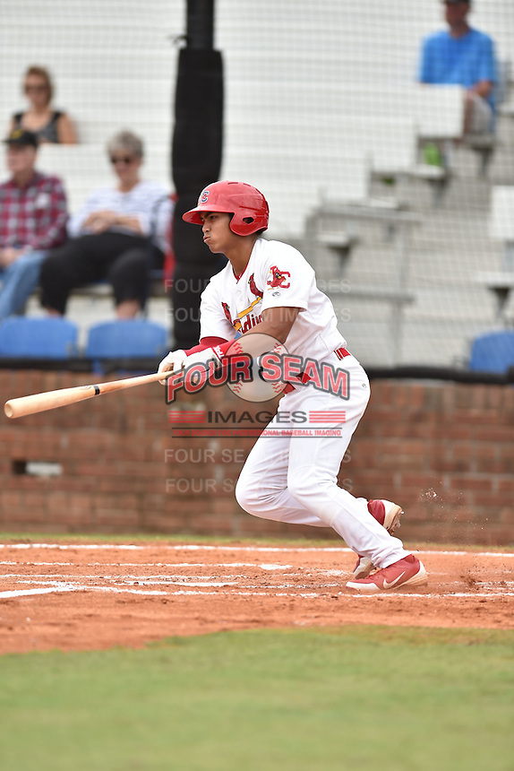 Johnson City Cardinals third baseman Chris Rivera #11 swings at a pitch during a game against the Bristol Pirates at Howard Johnson Field July 20, 2014 in Johnson City, Tennessee. The Pirates defeated the Cardinals 4-3. (Tony Farlow/Four Seam Images)