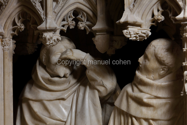 Statues of weepers under Gothic canopy from the tomb of Jean sans Peur, or John the Fearless, 1371-1419, (Jean de Valois or John of Valois, Jean I, duc de Bourgogne, or John I, Duke of Burgundy) and his wife Marguerite de Baviere, or Margaret of Bavaria, 1363- 1423, 1443-70, by Jean de la Huerta, 1413-62, and Antoine le Moiturier, 1425-97, in the Grande Salle du Palais des ducs de Bourgogne, or Salle des Gardes, a 15th century Flamboyant Gothic hall, in the Musee des Beaux-Arts de Dijon, opened 1787 in the Palace of the Dukes of Burgundy in Dijon, Burgundy, France. The tomb consists of painted alabaster effigies with lions and angels, and below, figures of pleurants or weepers among Gothic tracery. The tomb was begun in 1443 (24 years after his death), by Jean de La Huerta, and Antoine le Moiturier after 1456, and finally installed in 1470. The tombs were originally from the Chartreuse de Champmol, or Chartreuse de la Sainte-Trinite de Champmol, a Carthusian monastery which was sacked in the French Revolution and the tombs moved to Dijon cathedral then here in 1827. Picture by Manuel Cohen