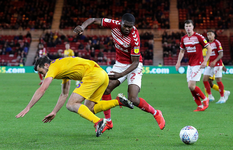 Preston North End's Joe Rafferty is tackled by  Middlesbrough's Anfernee Dijksteel<br /> <br /> Photographer Alex Dodd/CameraSport<br /> <br /> The EFL Sky Bet Championship - Middlesbrough v Preston North End - Tuesday 1st October 2019  - Riverside Stadium - Middlesbrough<br /> <br /> World Copyright © 2019 CameraSport. All rights reserved. 43 Linden Ave. Countesthorpe. Leicester. England. LE8 5PG - Tel: +44 (0) 116 277 4147 - admin@camerasport.com - www.camerasport.com