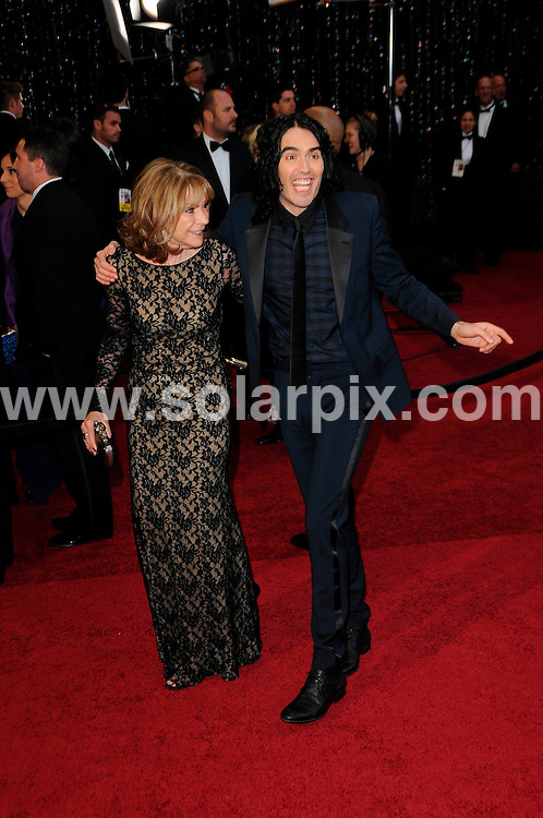 **ALL ROUND PICTURES FROM SOLARPIX.COM**                                             **SYNDICATION RIGHTS FOR UK, AUSTRALIA, DENMARK, PORTUGAL, S. AFRICA, SPAIN & DUBAI (U.A.E) & ASIA (EXCLUDING JAPAN) ONLY**                                                                                  Arrivals for the 83rd Annual Academy Awards, Kodak Theatre, Hollywood, CA, USA.                                                                        .This pic:      Russell Brand and mother Barbara.JOB REF:    12901    PHZ/Evans       DATE: 27.02.11                                                           **MUST CREDIT SOLARPIX.COM OR DOUBLE FEE WILL BE CHARGED**                                                                      **MUST AGREE FEE BEFORE ONLINE USAGE**                               **CALL US ON: +34 952 811 768 or LOW RATE FROM UK 0844 617 7637**