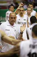 Tall Blacks coach Nenad Vucinic welcomes the team onto the court during the International basketball match between the NZ Tall Blacks and Australian Boomers at TSB Bank Arena, Wellington, New Zealand on 25 August 2009. Photo: Dave Lintott / lintottphoto.co.nz