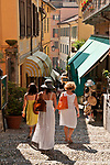 Walking down the step path lined with shops in Bellagio, Italy on Lake Como