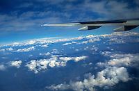 NEPAL airplane and clouds above Himalaya mountains / NEPAL Wolken am Himmel und Tragflaeche eines Flugzeug ueber Himalaya Gebirge