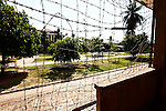 Barbed wire is strung across the front of a building containing former classrooms at the the Tuol Sleng prison in Phnom Penh, Cambodia. The Khmer Rouge turned this building into a mass detention cell, and the barbed wire was to prevent prisoners from escaping or throwing themselves to their deaths from the upper floors. March 1, 2012.