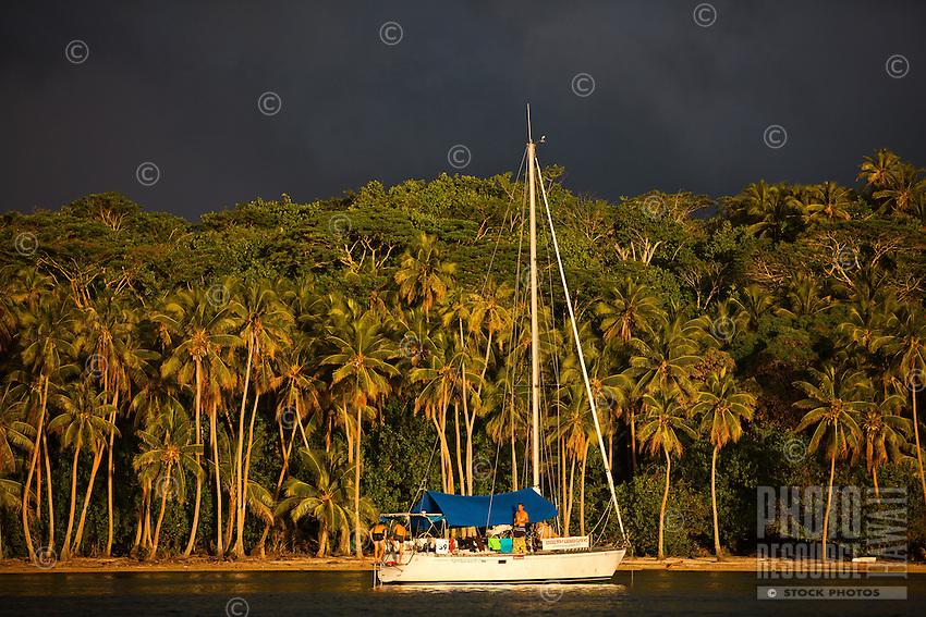 Yacht anchored off Bora Bora at sunset