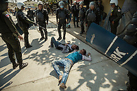 03 January, 2014 - Phnom Penh. Badly wounded protesters lie unconscious on the floor after been beaten by police. © Thomas Cristofoletti / Ruom 2014
