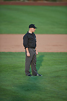 Umpire Bobby Tassone handles the calls on the bases during a game between the Ogden Raptors and the Great Falls Voyagers at Lindquist Field on August 22, 2018 in Ogden, Utah. Great Falls defeated Ogden 3-1. (Stephen Smith/Four Seam Images)