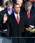 Washington, DC - January 20, 2009 -- United States President Barack Obama takes the oath of office as he is sworn in as the 44th President of the United States in Washington, DC, USA, 20 January 2009. Obama defeated Republican candidate John McCain on Election Day 04 November 2008 to become the next U.S. President.Credit: Matthew Barrick - CNP