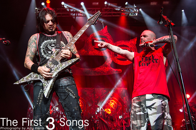 Jason Hook and Ivan Moody of Five Finger Death Punch performs during the 2013 Mayhem Festival at Klipsch Music Center in Indianapolis, Indiana.