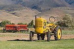 Restored tractor collection of Ron Smith along the Carson River, Nev...1941 John Deere model LI tractor (one of 500 of this model manufactured)..McCormick seeder behind