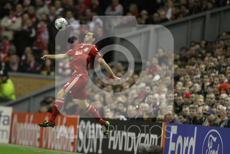 Alvaro Arbeloa jumps hgh to control the ball during the Champions League Round of 16, Second Leg match between Liverpool and Real Madrid at Anfield on March 10, 2009 in Liverpool, England