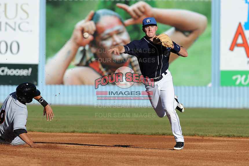 Asheville Tourists shortstop Trevor Story #3 throws to first to complete a double play during a game between the Delmarva Shorebirds and the Asheville Tourists at McCormick Field, Asheville, North Carolina April 7, 2012. The Tourists won game one of a double header  8-4  (Tony Farlow/Four Seam Images)..