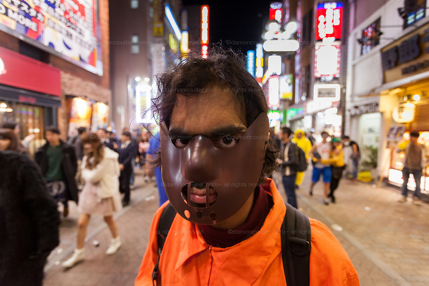 A young British Indian man dressed at a dangerous prisoner enjoys the Halloween celebrations in Shibuya. Saturday October 28th 2017