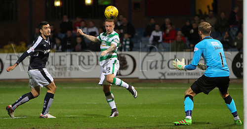 05.04.2016. Dens Park, Dundee, Scotland. Scottish Football Premiership Dundee versus Celtic. Leigh Griffiths heads the ball straight towards Scott Bain . The game ended in a dull 0-0 draw.