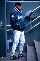 SEATTLE, WA - Manager Lou Piniella of the Seattle Mariners watches his team from the dugout during a game against the Texas Rangers at Safeco Field in Seattle, Washington in 2002. Photo by Brad Mangin
