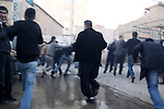 SULAIMANIYAH, IRAQ: Protesters run from charging policemen...A second day of protests rocked the Kurdish Iraqi city of Sulaimaniyah.  Security forces used, batons, water canons, and live rounds.  At least 14 people were wounded...Photo by Ali Arkady