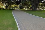 Brick walking path winding through the Christchurch Botanic Gardens, Christchurch, New Zealand