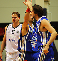 Arthur Trousdell and Kevin Owens high-five as Giants centre Christopher Reay (left) looks unimpressed during the NBL Semifinal basketball match between the Wellington Saints and Nelson Giants at TSB Bank Arena, Wellington, New Zealand on Thursday, 12 June 2008. Photo: Dave Lintott / lintottphoto.co.nz