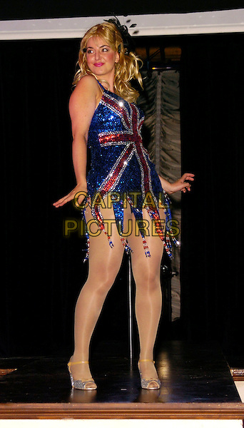"""REBECCA GETHINGS.""""The Vegemite Tales"""" photocall, The Venue Theatre, London, UK..August 1st, 2006.Ref: CAN.full length union jack sequins sequins sequined dress hand on hip blue red.www.capitalpictures.com.sales@capitalpictures.com.©Can Nguyen/Capital Pictures"""