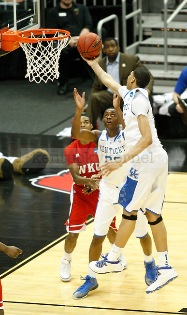 UK forward Anthony Davis grabs a rebound during the first half of the UK vs. WKU NCAA second round game at the KFC Yum! Center March 15, 2012. Photo by Brandon Goodwin | Staff