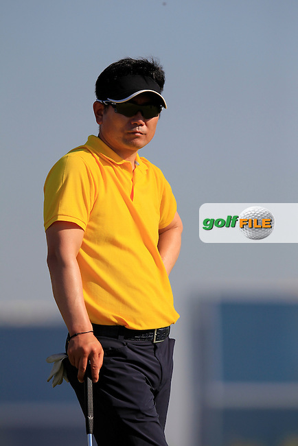 Y.E. YANG (KOR) on the 10th green during Thursday's Round 2 of the 2015 Commercial Bank Qatar Masters held at Doha Golf Club, Doha, Qatar.: Picture Eoin Clarke, www.golffile.ie: 1/22/2015