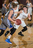 NWA Democrat-Gazette/ANTHONY REYES • @NWATONYR<br /> Morgan Vaughn (14), Siloam Springs sophomore, defends Maddi McKinney, Rogers junior, Wednesday, Dec. 30, 2015 at Panther Gymnasium in Siloam Springs.