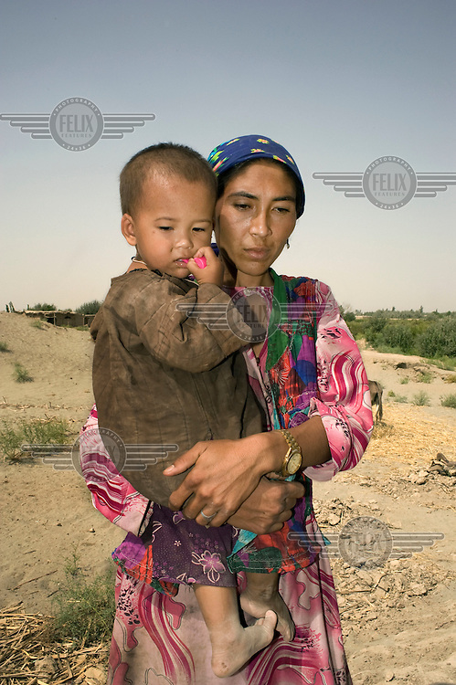 A woman holds her son.