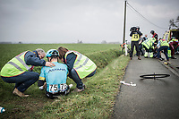 Alexey Lutsenko (KAZ/Astana) aided by the roadside after a peloton crash.<br /> <br /> <br /> 102nd Ronde van Vlaanderen 2018 (1.UWT)<br /> Antwerpen - Oudenaarde (BEL): 265km