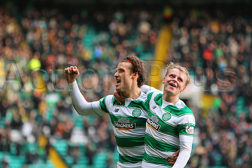 20.02.2016. Celtic Park, Glasgow, Scotland. Scottish Premier League. Celtic versus Inverness CT. Gary Mackay-Steven celebrates with Erik Sviatchenko