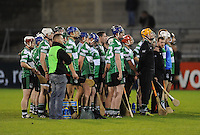24th October 2013; Lucan Sarsfields players stand for a minute silence in memory of the late Galway hurler Niall Donoghue. Dublin County Senior Hurling Championship Semi-Final, Craobh Chiarain v Lucan Sarsfields, Parnell Park, Dublin. Picture credit: Tommy Grealy / actionshots.ie