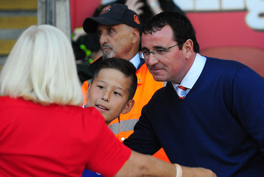 Blackpool manager Gary Bowyer poses for a picture with a young fan<br /> <br /> Photographer Kevin Barnes/CameraSport<br /> <br /> Football - The EFL Sky Bet League Two - Blackpool v Exeter City - Saturday 6th August 2016 - Bloomfield Road - Blackpool<br /> <br /> World Copyright &copy; 2016 CameraSport. All rights reserved. 43 Linden Ave. Countesthorpe. Leicester. England. LE8 5PG - Tel: +44 (0) 116 277 4147 - admin@camerasport.com - www.camerasport.com