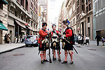 Saturday, April 14,  2007, New York, New York.. The 9th annual Tartan Day Parade was held today on 6th Avenue between 44th and 58th Streets.. Thousands turned out to play the drums, pipes and to view all those dressed for the occasion.. (left to right) Tom Patton, Andrew Law and James Puzar ready themselves for the parade march.