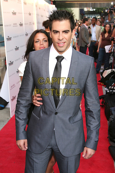 "VANESSA FERLITO & ELI ROTH .New York Screening of ""Inglourious Basterds"" held at the SVA Theatre, New York, NY, USA, .August 17th 2009..half length white grey gray black tie sneaking up behind .CAP/LNC/TOM.©LNC/Capital Pictures."